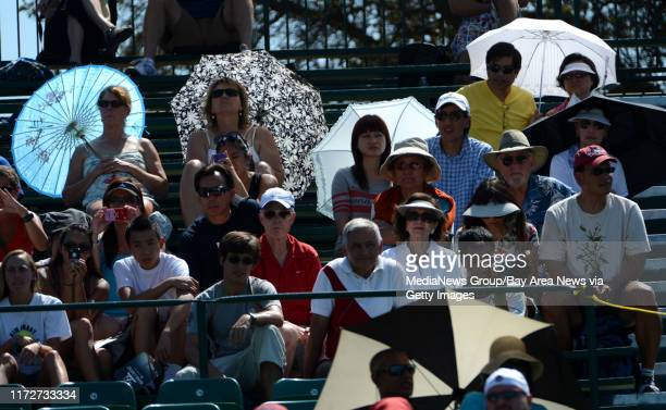 Tennis fans watch Serena Williams in the first set of her match against Nicole Gibbs for the Bank of the West Classic tennis tournament at Taube...