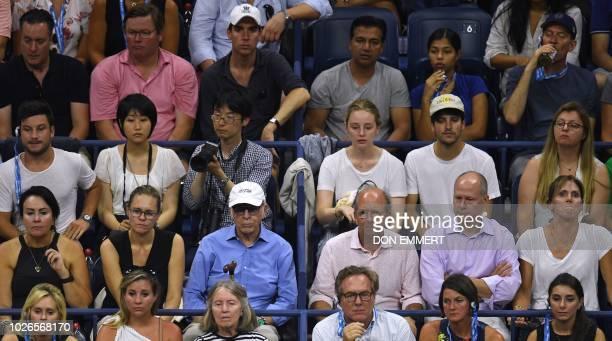 Tennis fans watch the 2018 US Open Women's Singles tennis match between Spain's Carla Suarez Navarro and Russia's Maria Sharapova at the USTA Billie...