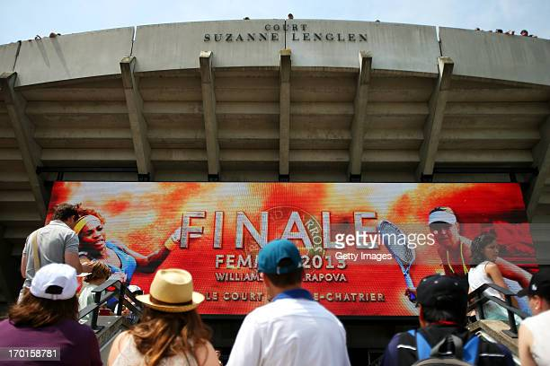Tennis fans watch the big screen outside Court Suzanne Lenglen before the Women's Singles final match between Serena Williams of United States of...