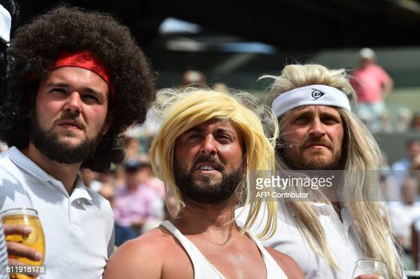 TOPSHOT Tennis fans wearing wigs resembling legendary players watch Spain's Rafael Nadal play against Luxembourg's Gilles Muller during their men's...