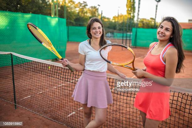 tennis female players in tennis court - sport set competition round stock photos and pictures