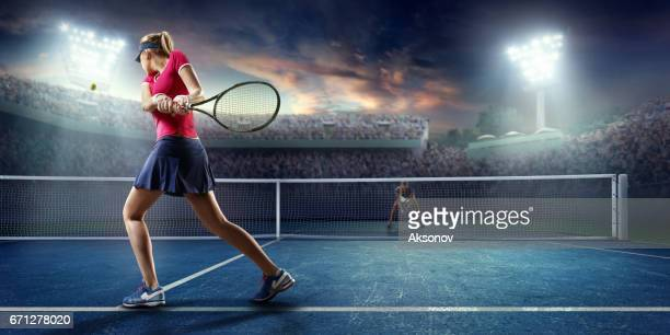 tennis: female sportsman in action - tennis stock pictures, royalty-free photos & images