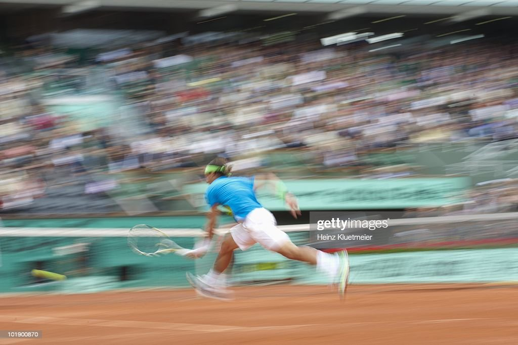 Blur view of Spain Rafael Nadal in action vs Brazil Thomaz Bellucci during Men's 4th Round at Stade Roland Garros. Paris, France 5/31/2010