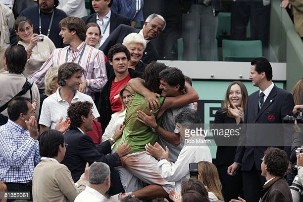 Tennis French Open ESP Rafael Nadal victorious with uncle and coach Miguel Angel Nadal in stands surrounded by fans after winning finals match vs ARG...