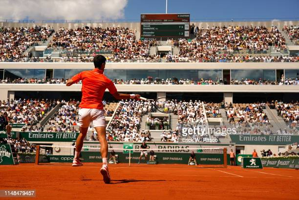 French Open Rear view of Serbia Novak Djokovic in action vs Germany Alexander Zverev during Men's Quarterfinals at Stade Roland Garros Sequence Paris...