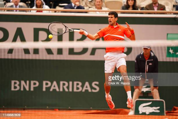 French Open Serbia Novak Djokovic in action vs Austria Dominic Thiem during Men's Semifinals match at Stade Roland Garros Match was continued after...