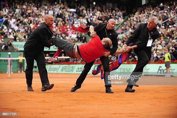 French Open View of spectator Jimmy Jump after running onto court and getting tackled by security officers during Roger Federer vs Robin Soderling...