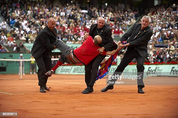 French Open View of spectator Jimmy Jump getting carried out by security officers after running onto court during Roger Federer vs Robin Soderling...