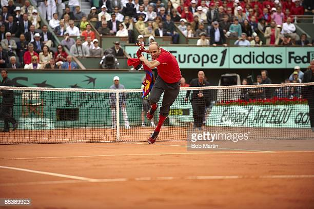 French Open View of spectator Jimmy Jump running onto court and jumping net during Roger Federer vs Robin Soderling Men's Final match at Roland...
