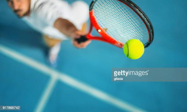 tennis game at night. - taking a shot sport stock pictures, royalty-free photos & images