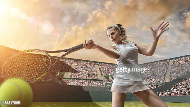 tennis girl in close up hitting ball - wimbledon stock pictures, royalty-free photos & images