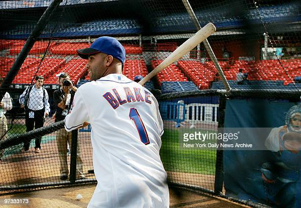 Tennis great James Blake takes batting practice in the cage before the start of a game between the New York Mets and the St Louis Cardinals at Shea...