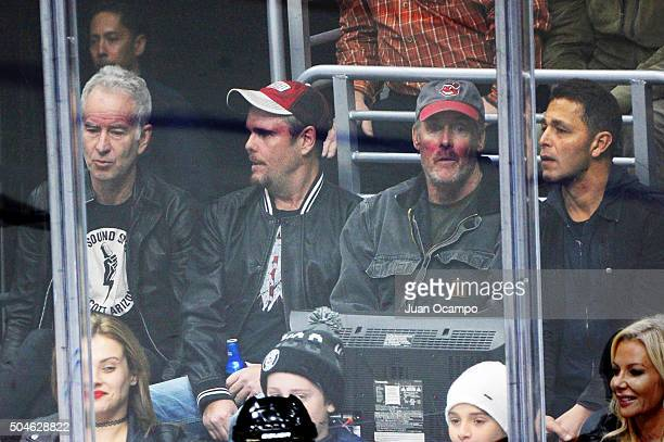 Tennis great John McEnroe Entourage actor Kevin Dillon Scrubs actor John C McGinley and friend/restaurant owner Nate watch the game between the Los...