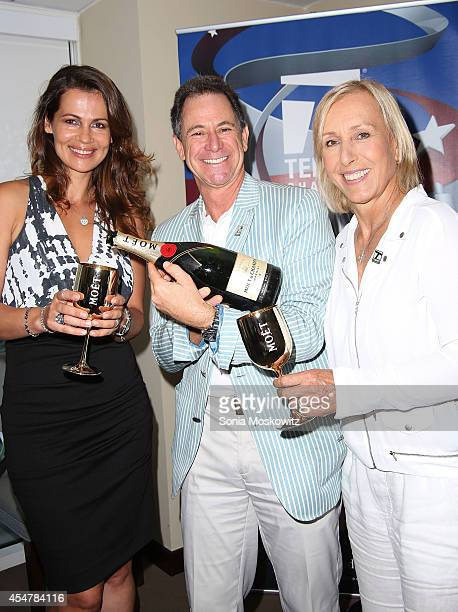 Tennis great Martina Navratilova becomes engaged to Russie Blanche skin care company founder Julia Lemigova during the 2014 US Open at USTA Billie...