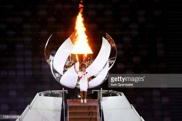 Tennis great Naomi Osaka lights the caldron during the Opening Ceremony of the Tokyo 2020 Olympic Games at Olympic Stadium on July 23, 2021 in Tokyo,...