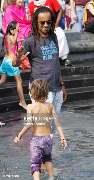 Tennis great Yannick Noah and son Joalukas Noah are seen at the fountain in Washington Square Park on June 12 2010 in New York New York