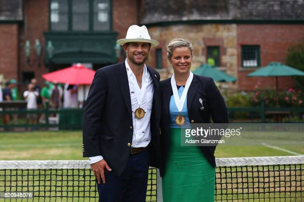 Tennis Hall of Fame inductees Kim Clijsters of Belgium and Andy Roddick of the United States pose for a photo following the enshrinement ceremonies...