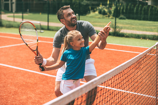 Tennis is fun when father is near. 544595788