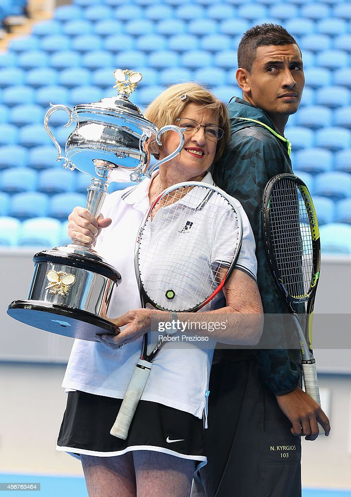 Tennis legend Margaret Court and Australian tennis player Nick Kyrios pose for photos during the 2015 Australian Open launch at Melbourne Park on October 7, 2014 in Melbourne, Australia.