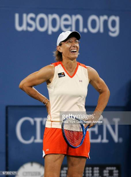 Tennis legend Martina Navratilova laughs as she and fellow American Bob Bryan take on Anna-Lena Groenefeld of Germany and Frantisek Cermak of the...