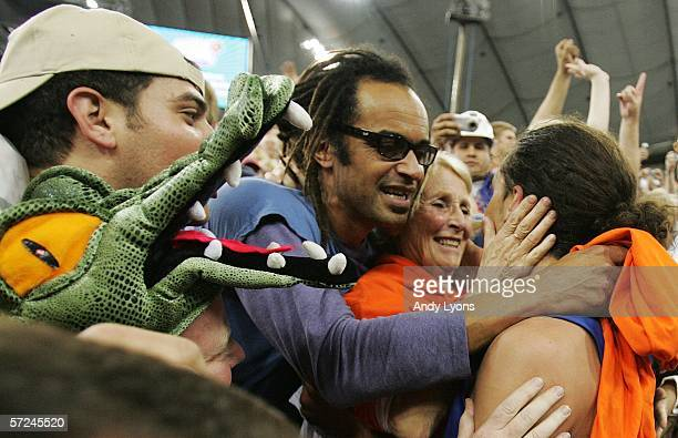 Tennis legend Yannick Noah congratulates his son Joakim Noah of the Florida Gators after defeating the UCLA Bruins 73-57 in the National Championship...