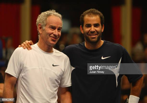 Tennis legends John McEnroe and Pete Sampras of United States pose for photos before the BlackRock Masters Tennis at the Royal Albert Hall on...