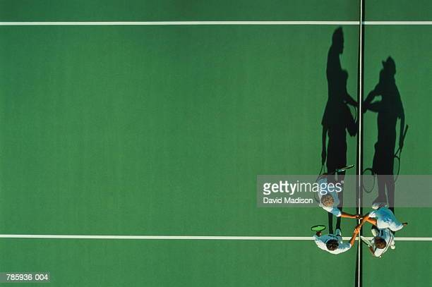 Tennis, male players shaking hands over net, overhead view