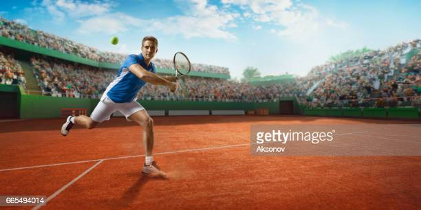 tennis: male sportsman in action - racquet sport stock photos and pictures