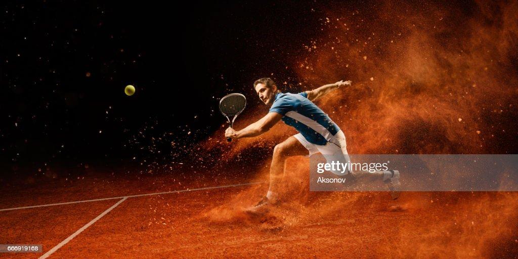Tennis: Mâle sportif en action : Photo