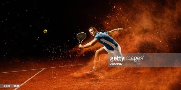tennis: male sportsman in action - taking a shot sport stock pictures, royalty-free photos & images