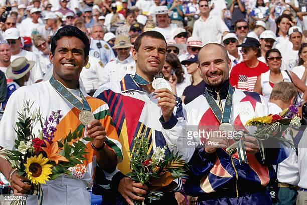 Tennis men's singles finalist left bronze medal winner Leander Paes of India center silver medal winner Sergi Bruguera of Spain and right gold winner...