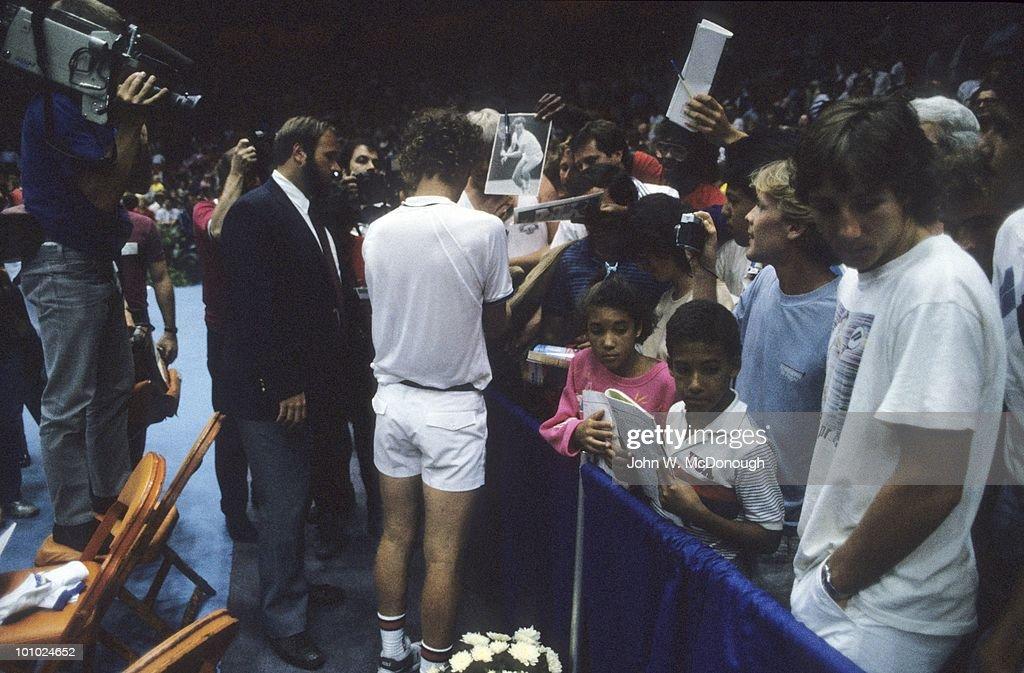 USA John McEnroe signing autographs for fans before exhibition match vs Czechoslovakia Ivan Lendl at Los Angeles Forum. Inglewood, CA 7/28/1986