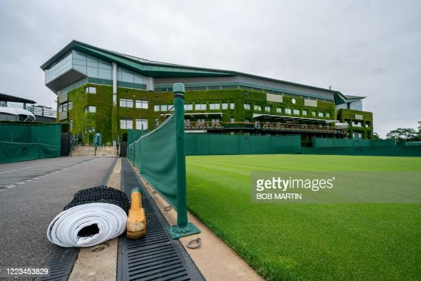 A tennis net is rolled up by Court 5 at the All England Lawn Tennis Club in west London on June 27 2020 on what would have been the first day of the...