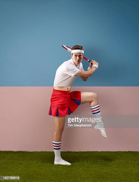 tennis palyer top, cheer leader bottom - cheerleader up skirt stock photos and pictures