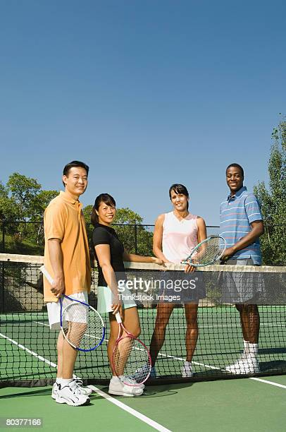 tennis partners at net - doubles sports competition format stock pictures, royalty-free photos & images