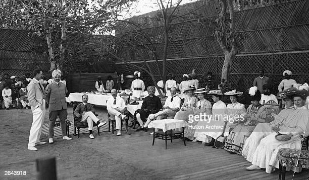 A tennis party in honour of the Major and Mrs Beale during the days of the British Raj