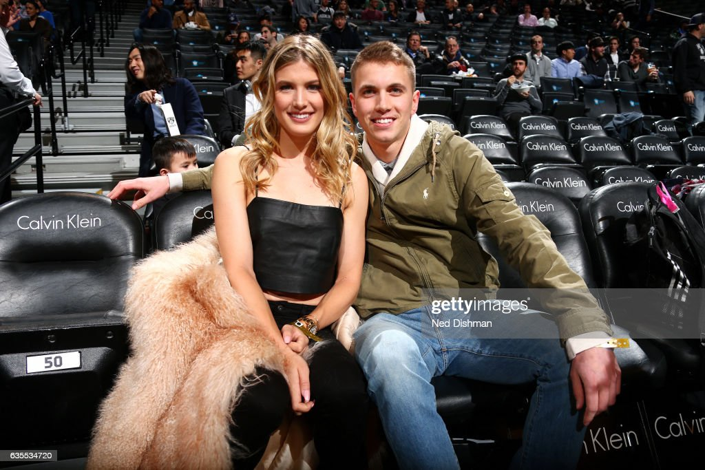 Tennis payer, Genie Bouchard poses for a picture with her date during the game between the Brooklyn Nets and the Milwaukee Bucks on February 15, 2017 at Barclays Center in Brooklyn, New York.