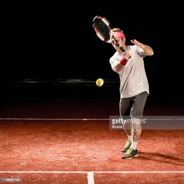 tennis player action: forehand - ilbusca foto e immagini stock