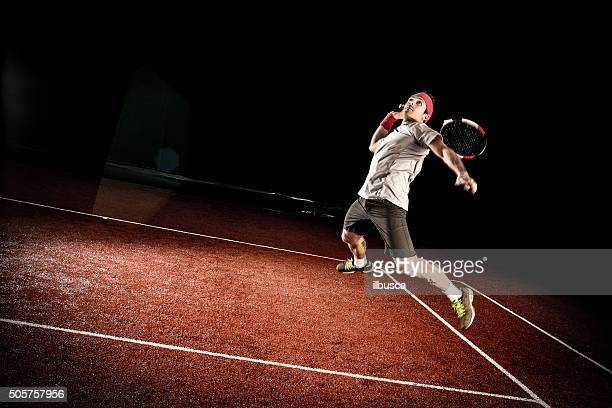 Tennis player action: Jumping smash
