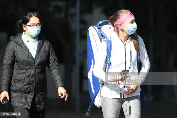 Tennis player Aleksandra Krunić of Serbia is escorted by a Hotel Qurantine staff member as Krunic walks out of 'The View' Hotel to practice at...