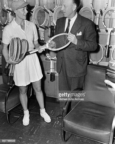 Tennis player Alice Marble talks racks during the Pacific Southwest Tennis Match in Los Angeles California
