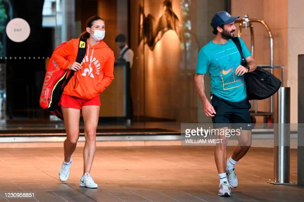 Tennis player and coach leave the Grand Hyatt hotel in Melbourne on February 4 as preparations for the Australian Open were thrown into chaos when up...
