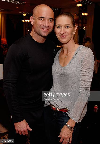 Tennis player and founder of the Andre Agassi Charitable Foundation, Andre Agassi, and his wife tennis player Steffi Graf, pose at the Distinctive...
