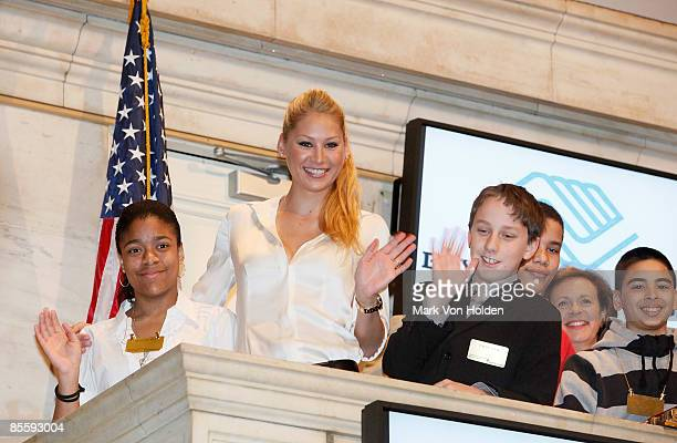Tennis Player and Model Anna Kournikova and children from the Boys Girls Club of America ring the New York Stock Exchange opening bell on March 25...