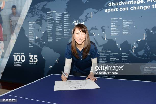 Tennis player and New Laureus Ambassador Ai Sugiyama signs her certificate prior to the Laureus World Sports Awards at the Meridien Beach Plaza on...