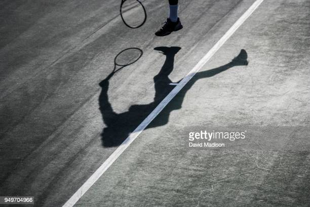 tennis player and shadow - tennis player stock pictures, royalty-free photos & images