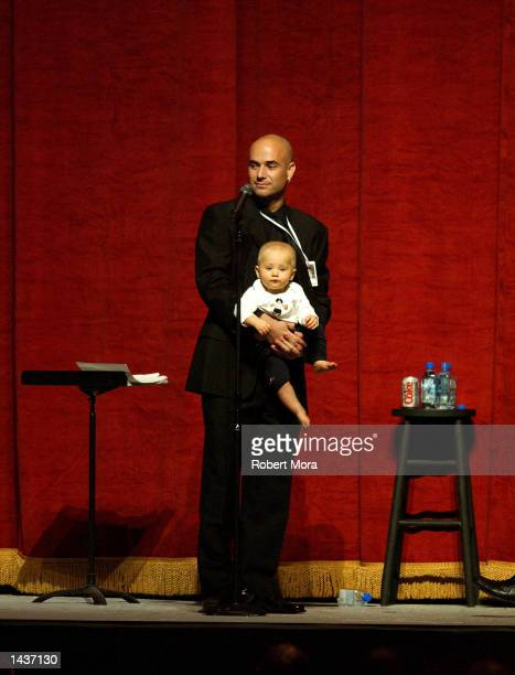 Tennis player Andre Agassi and his son Jaden stand on stage during an auction prior to the 7th Annual Andre Agassi Charitable Foundation's Grand Slam...
