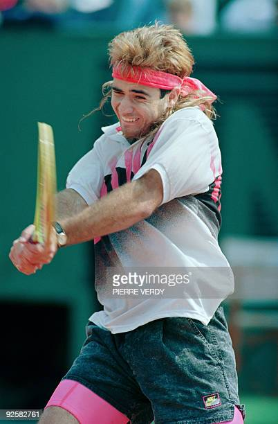 US tennis player Andre Agassi hits the ball in his match against Ecuadorian Andres Gomez during the Men's French Open final on June 10 1990 at Roland...