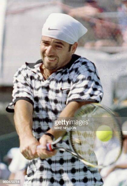 US tennis player Andre Agassi returns a backhand to Sweden's Mats Wilander during first set action at the Davis Cup SemiFinals 22 September in Las...