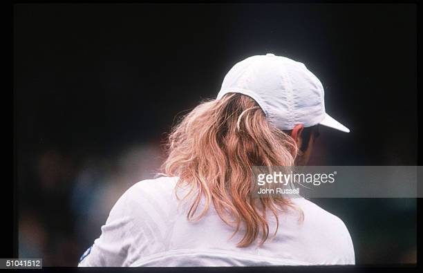 Tennis Player Andre Agassi Returns A Serve During The Wimbledon Tournament July 5 1992 In England Agassi Won His First Grand Slam Title At Wimbledon...